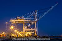 Port container crane waits at night. Oakland, CA