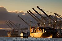 Port terminals, ships and passing ferry. Oakland, CA