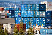 Blue shipping containers at port terminal. Oakland, CA
