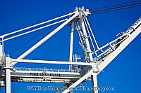 Blue sky and multiple stairways on crane at port. Oakland, CA
