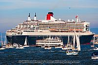 Queen Mary 2 surrounded by boats in San Francisco Bay. CA