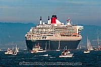 Passengers line decks of Queen Mary 2 in San Francisco Bay. CA